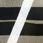 Shadows and white stripe form a not-equal-to sign.